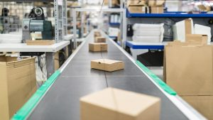 Packages on conveyor belt in distribution centre